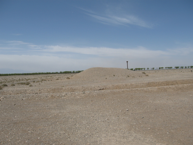 The unassuming earth mound... the tomb is 10 meters underground
